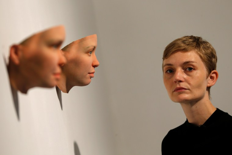 Image: Artist Heather Dewey-Hagborg poses with 3-D printed masks created from DNA extracted from cheek swabs and hair clippings she received from formerly imprisoned U.S. Army Private Chelsea Manning ahead of exhibition in New York
