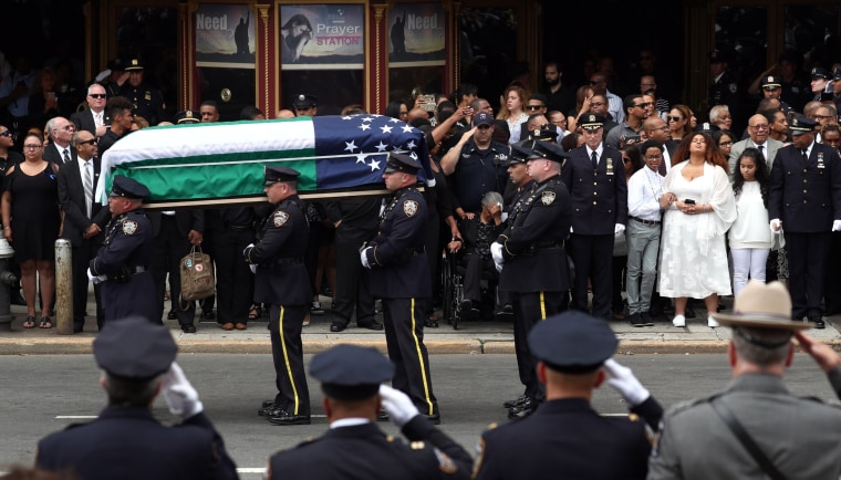 Image: The casket  of  slain New York Police Department (NYPD) Officer Miosotis Familia is carried from the World Changers Church