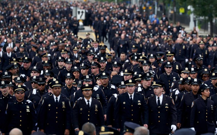 Image: Police officers line up outside the funeral of slain New York Police Department Officer Miosotis Familia