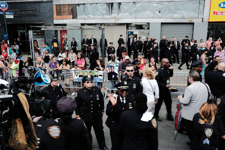 Image: Police officers stand outside of a Bronx church during the funeral for NYPD Officer Miosotis Familia
