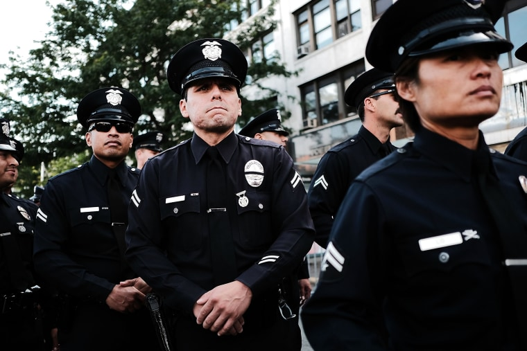 Image: Police from Los Angeles stand outside of a Bronx church during the funeral for NYPD Officer Miosotis Familia,