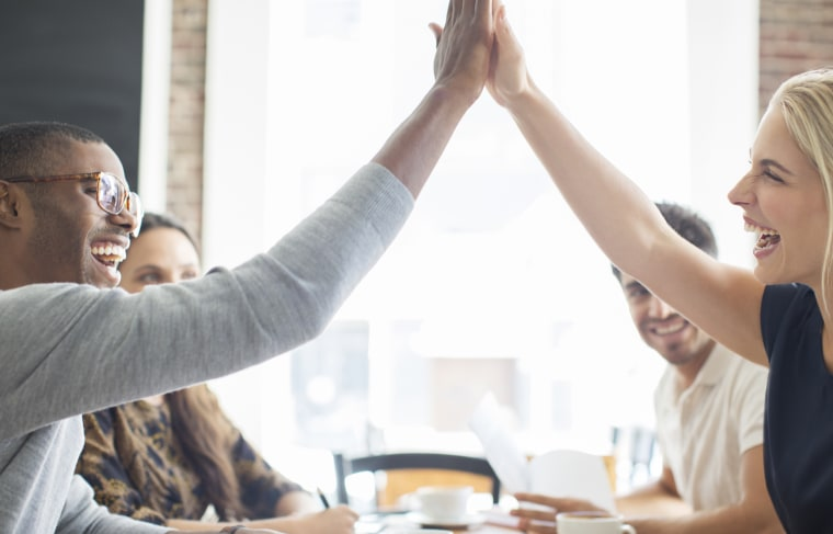 Image: Colleagues high five each other