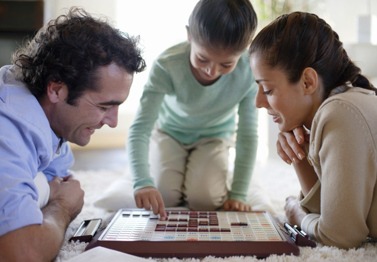 Image: A family plays a board game.