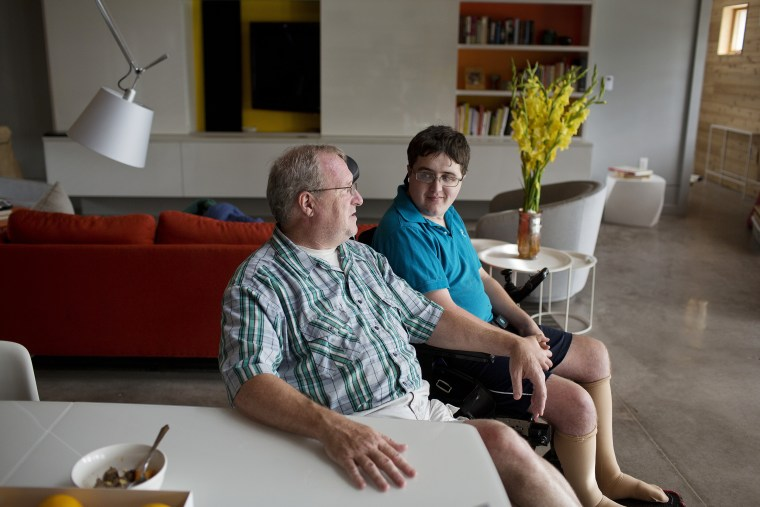 Image: Ed Slattery talks with his son Matthew, 16, at their home in Timonium, Maryland