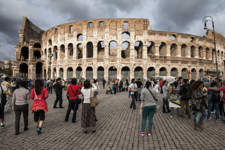 Image: Tourists visit the Colosseum in Rome