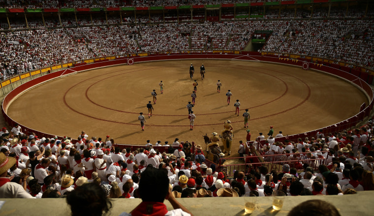 Image: Bullfighters enter the arena