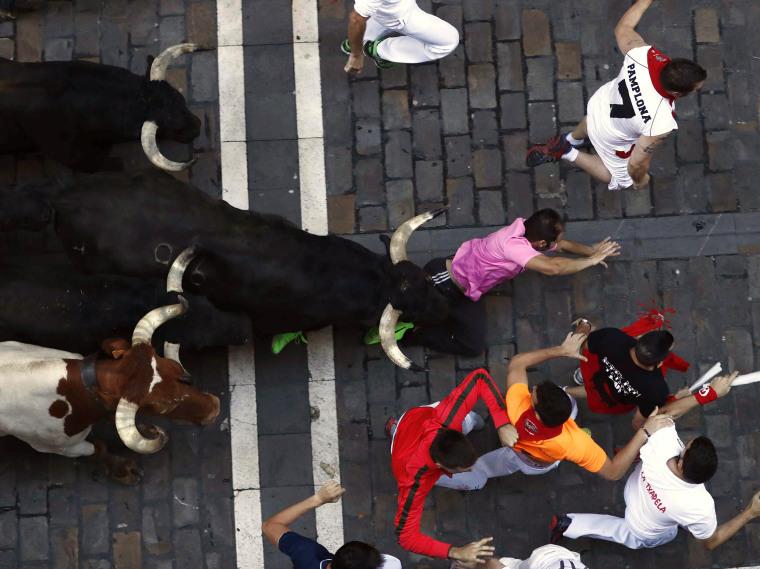 Image: A bull runner falls down