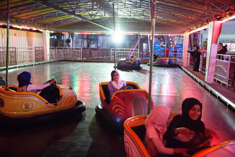 Image: Malala Yousafzai visits an amusement park with children displaced by ISIS conflict