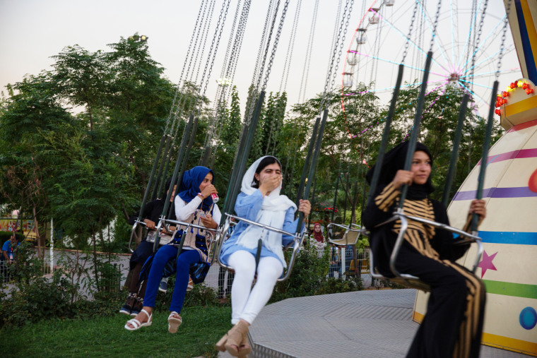 Image: Malala Yousafzai visits an amusement park and rides the swings