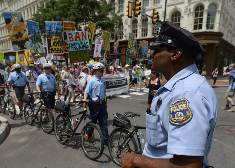Image: Police block traffic as protesters march in the street ahead of Monday's start of the Democratic National Convention in Philadelphia