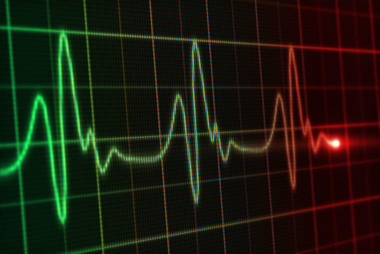 A close up of the digital screen of a heart monitor