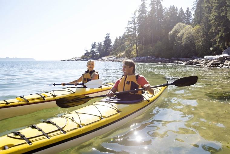 Image: Couple Kayaking on Sunny Ocean