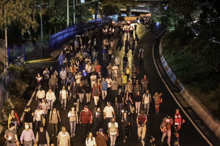 Image: Opposition holds memorial march in Caracas