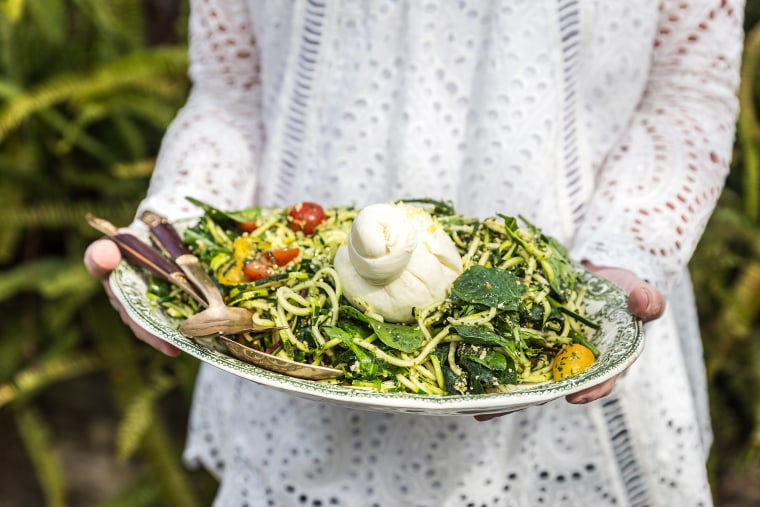 Image: Woman holding a Summer zucchini salad