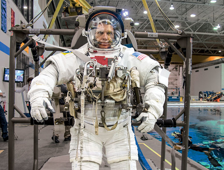 Terry Virts prepares for spacewalk training in the Neutral Buoyancy Laboratory at Johnson Space Center in Houston.