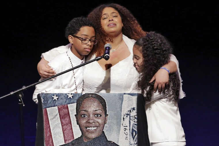 Image: The children of slain New York City police officer Miosotis Familia participate in their mother's funeral