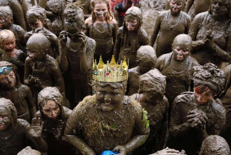 Image: Brian Wilson, 10, of Redford, smiles after he was crowned Mud Day King