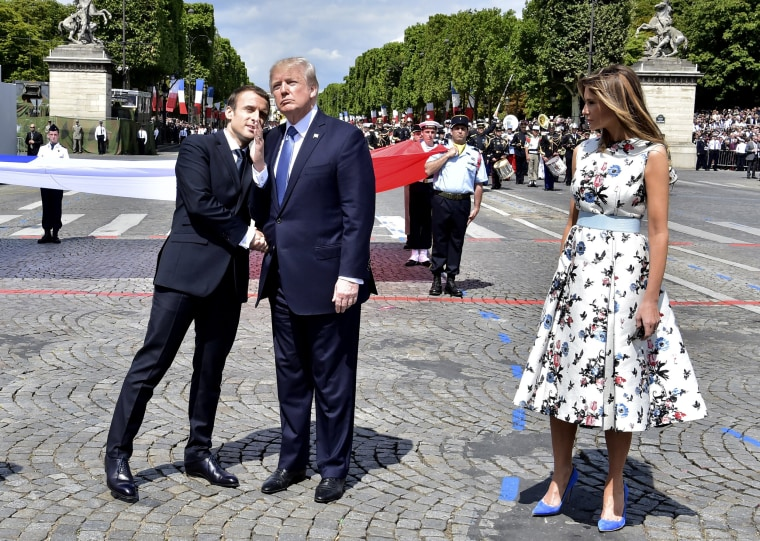 Image: French President Emmanuel Macron, left, shakes hands with U.S President Donald Trump