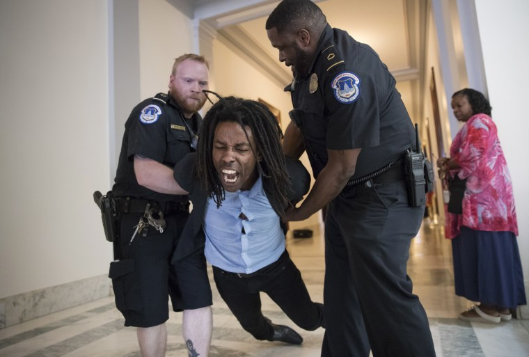 Image: A demonstrator is taken into custody by U.S. Capitol Police