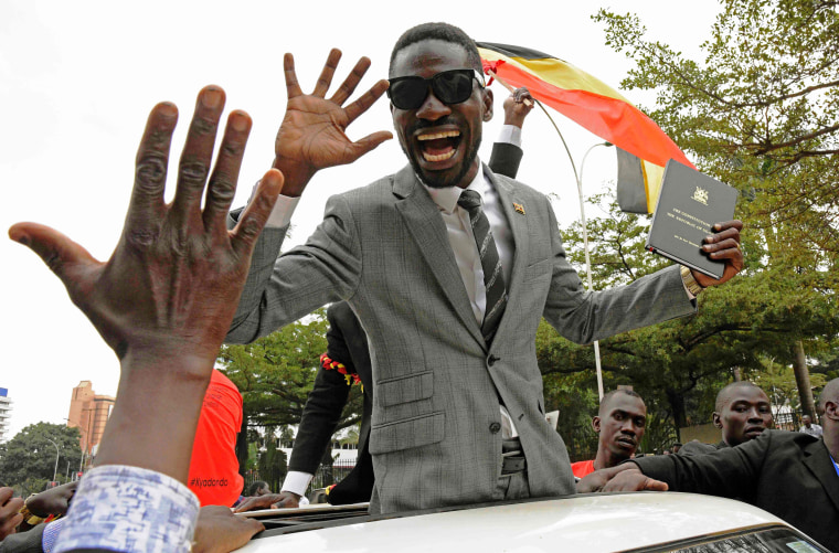 Image: Robert Kyagulani waves to his supporters moments after being sworn in as a Ugandan Member of Parliament