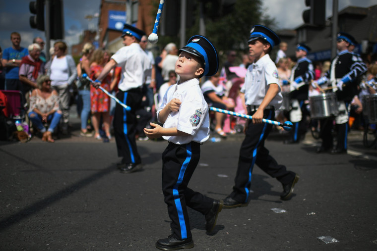 Image: Members of the Orange Order and their supporters take part in the Twelfth of July parade