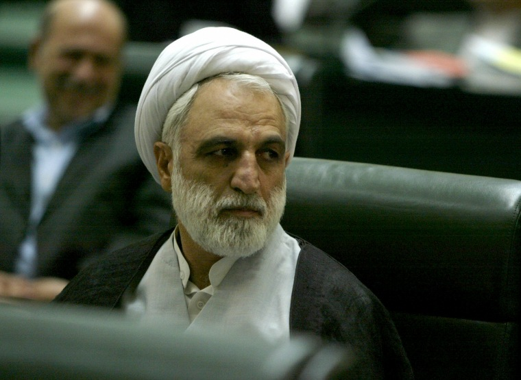 Image: First Deputy of the Chief Justice of Iran Gholamhossein Mohseni-Ejei listens to a member of parliament's speech at the Iranian parliament, Aug. 21, 2005.