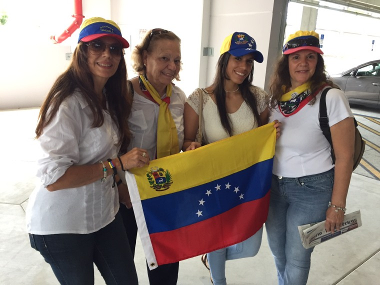 A group of women wear the Venezuelan flag colors after voting against Nicolas Maduro in an unofficial referendum at the campus of Miami Dade College in Doral, Florida.