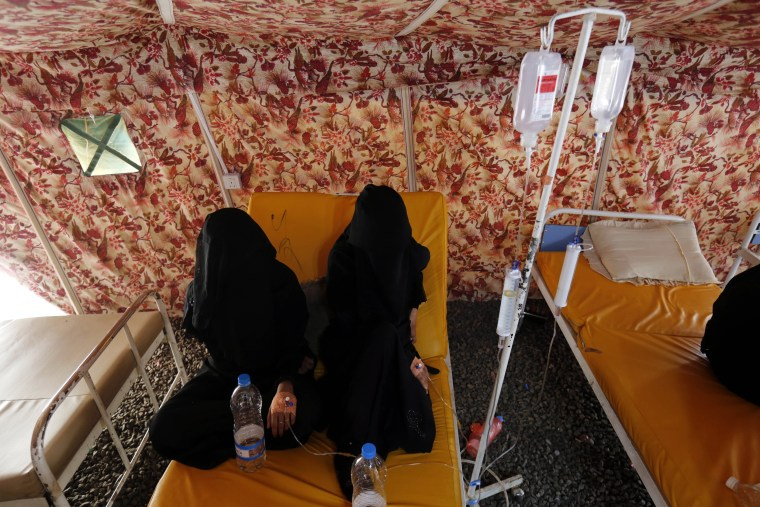 Image:  Cholera-infected Yemeni women receive treatment at a hospital