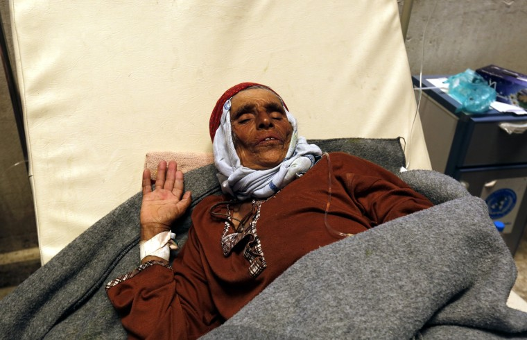 Image: A Yemeni woman infected with cholera receives treatment at a hospital