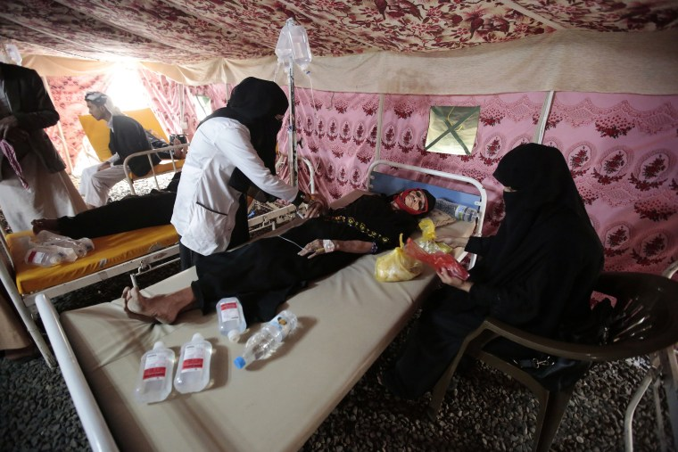 Image: An elderly woman is treated for suspected cholera infection in a tent at a hospital in Sanaa, Yemen,