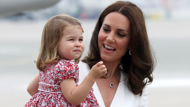 Kate, Duchess Of Cambridge, and Princess Charlotte, during trip to Poland