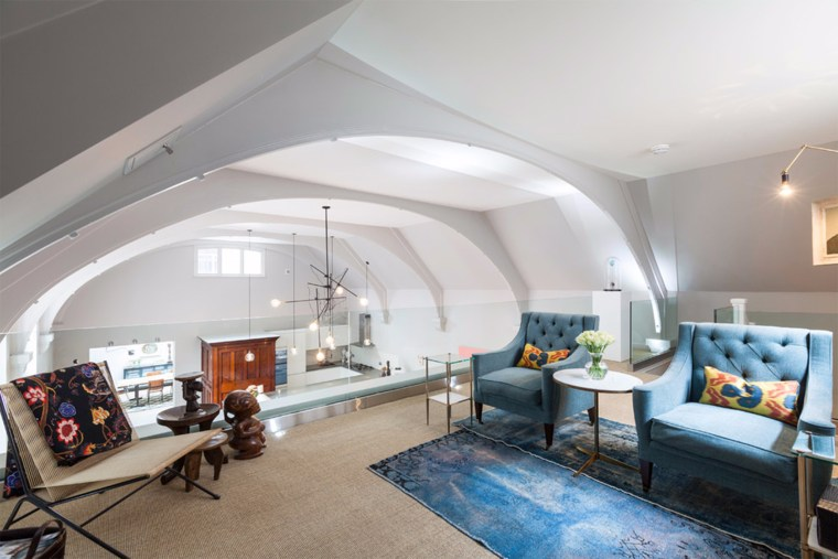 A lofted upper-level over looks the expansive living room space.