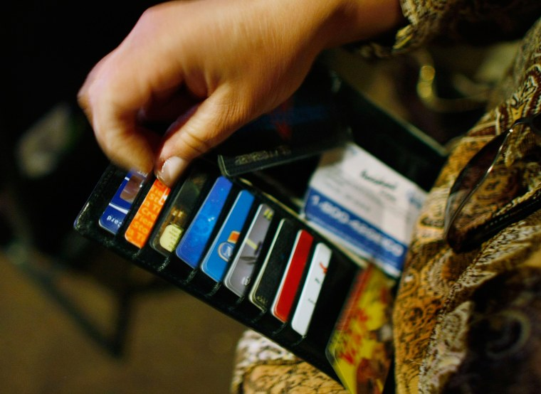 Image: A woman pulls out a credit card