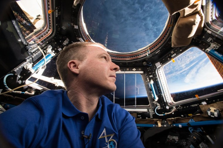 Terry Virts in the Cupola, the seven-windowed observation module on the International Space Station.