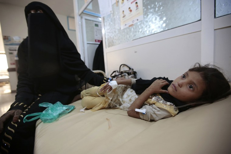 Image: A girl is treated for suspected cholera infection at a hospital in Sanaa