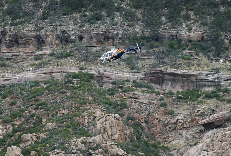 Image: A helicopter flies above the rugged terrain along the banks of the East Verde River