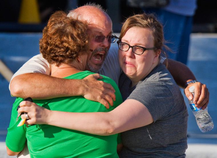 Image: Tom Sullivan embraces family members