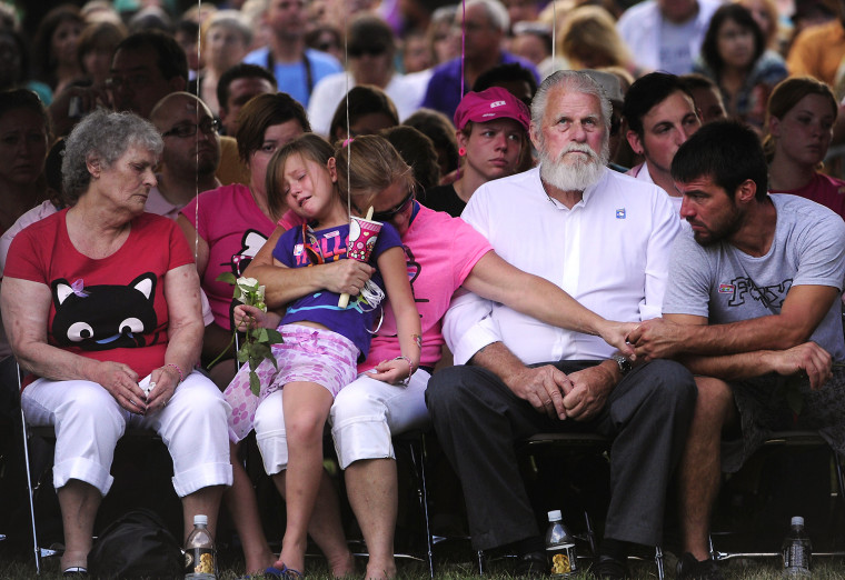 Image: People mourn at a vigil