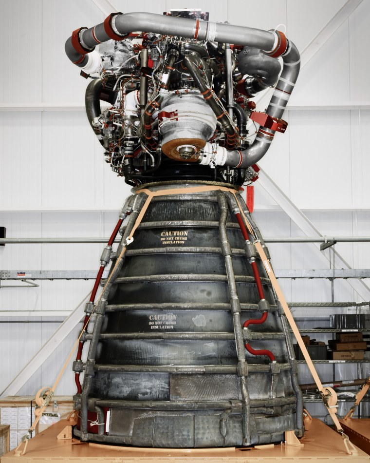A space shuttle main engine on rolling stand.