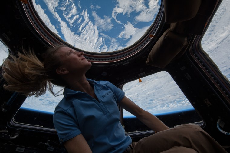 NASA astronaut Karen Nyberg enjoys the view of Earth from the windows in the Cupola of the International Space Station in 2013.