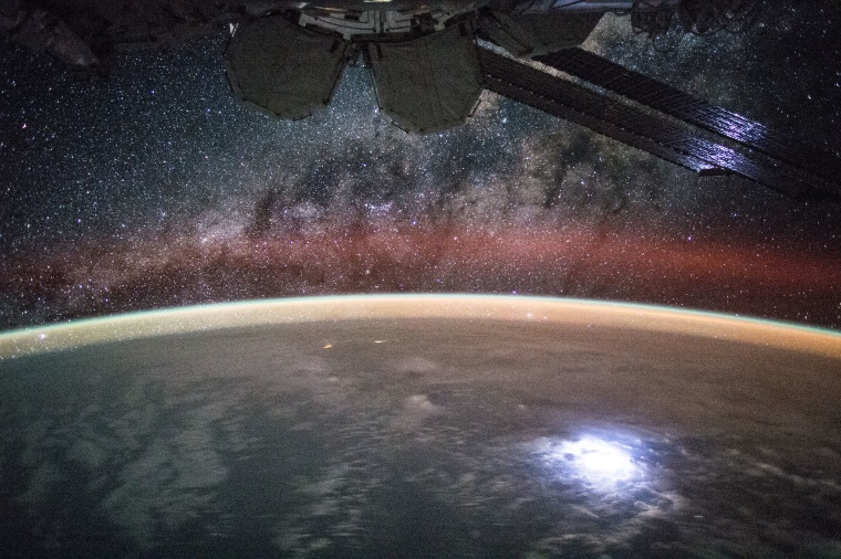 Astronaut Kjell Lindgren captured a lightning strike from space so bright that it lights up the space station's solar panels.