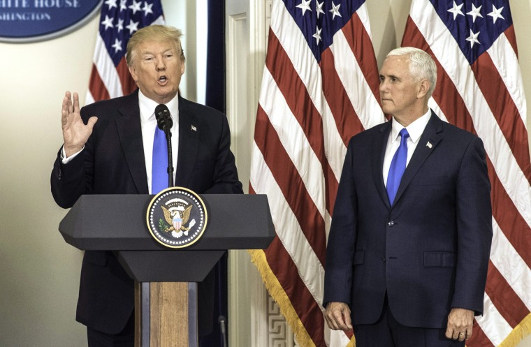 Image: President Donald Trump makes opening remarks next to Vice President Mike Pence
