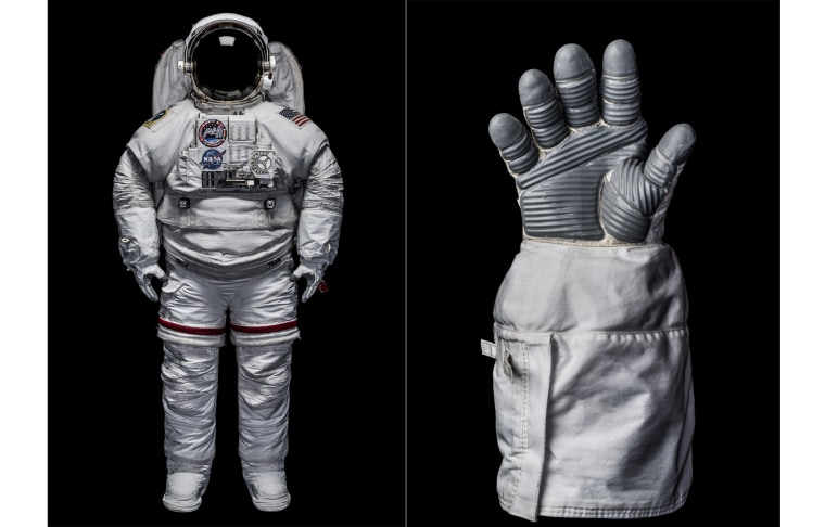An Extravehicular Mobility Unit (EMU) space suit and glove.