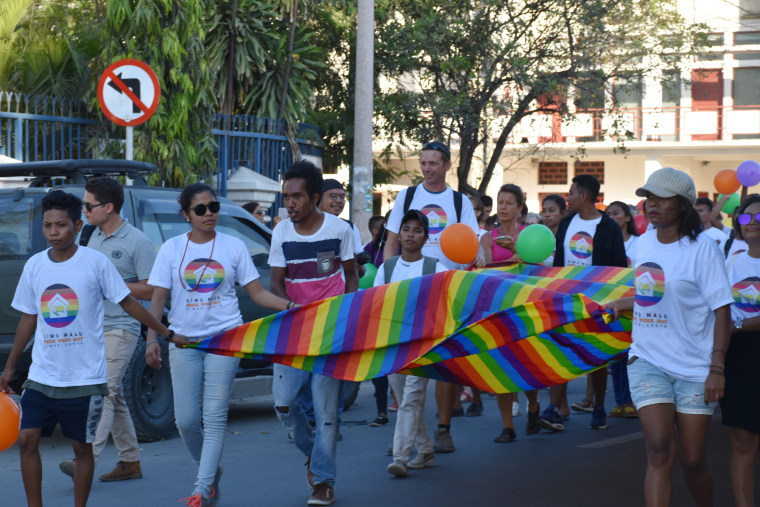 Image: Participants carry a flag during the Pride March in Dili, East Timor