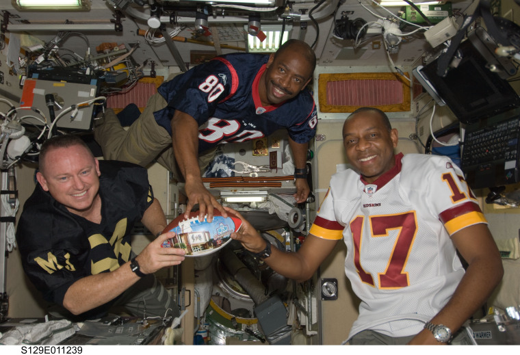 Melvin (center) and crewmates on the ISS.