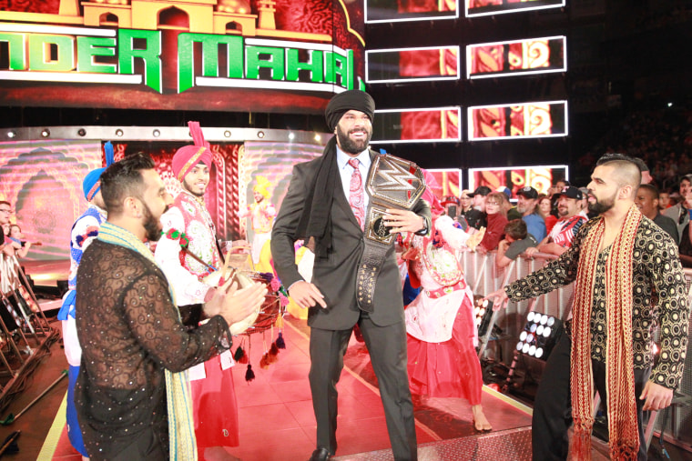 Professional wrestler Jinder Mahal (center) with his entourage, the Singh Brothers (front), celebrating his WWE Championship win.