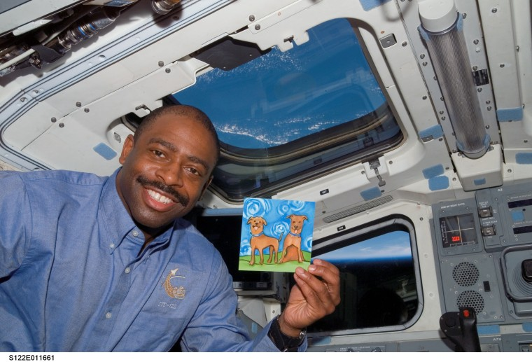 Leland with a picture of his boys on Shuttle Atlantis in February 2008