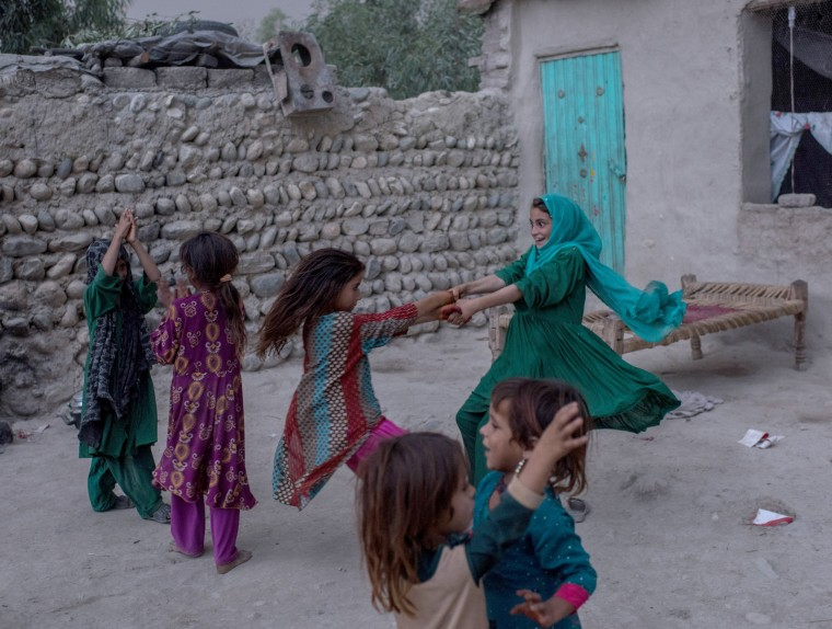 Image: Afghan children play at their home