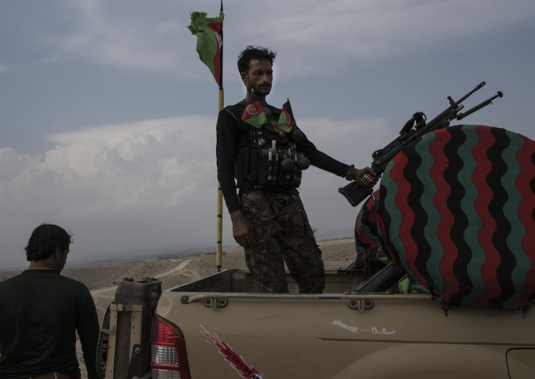 Image: An Afghan soldier stands in a truck