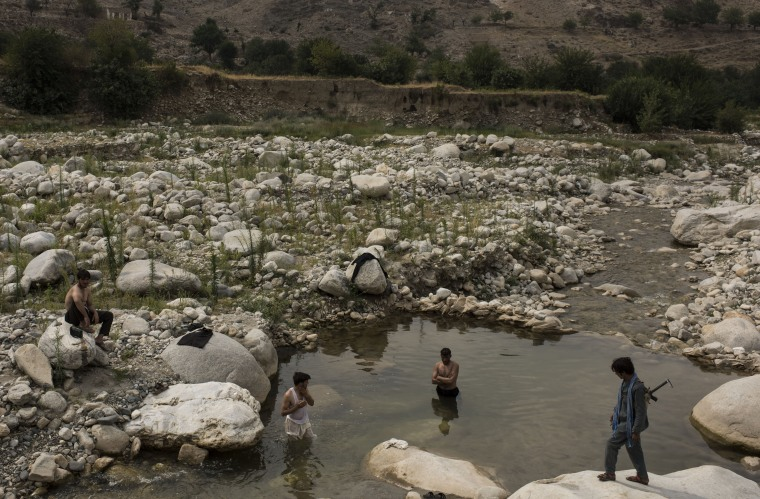 Image: Men bathe in a river in the Momand Valley